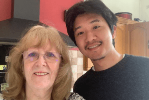 Japanese student taking a selfie with his host mom